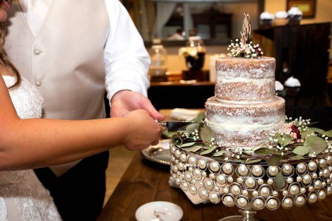 Couple cutting their small wedding cake. Photo by Bill Payne Photography